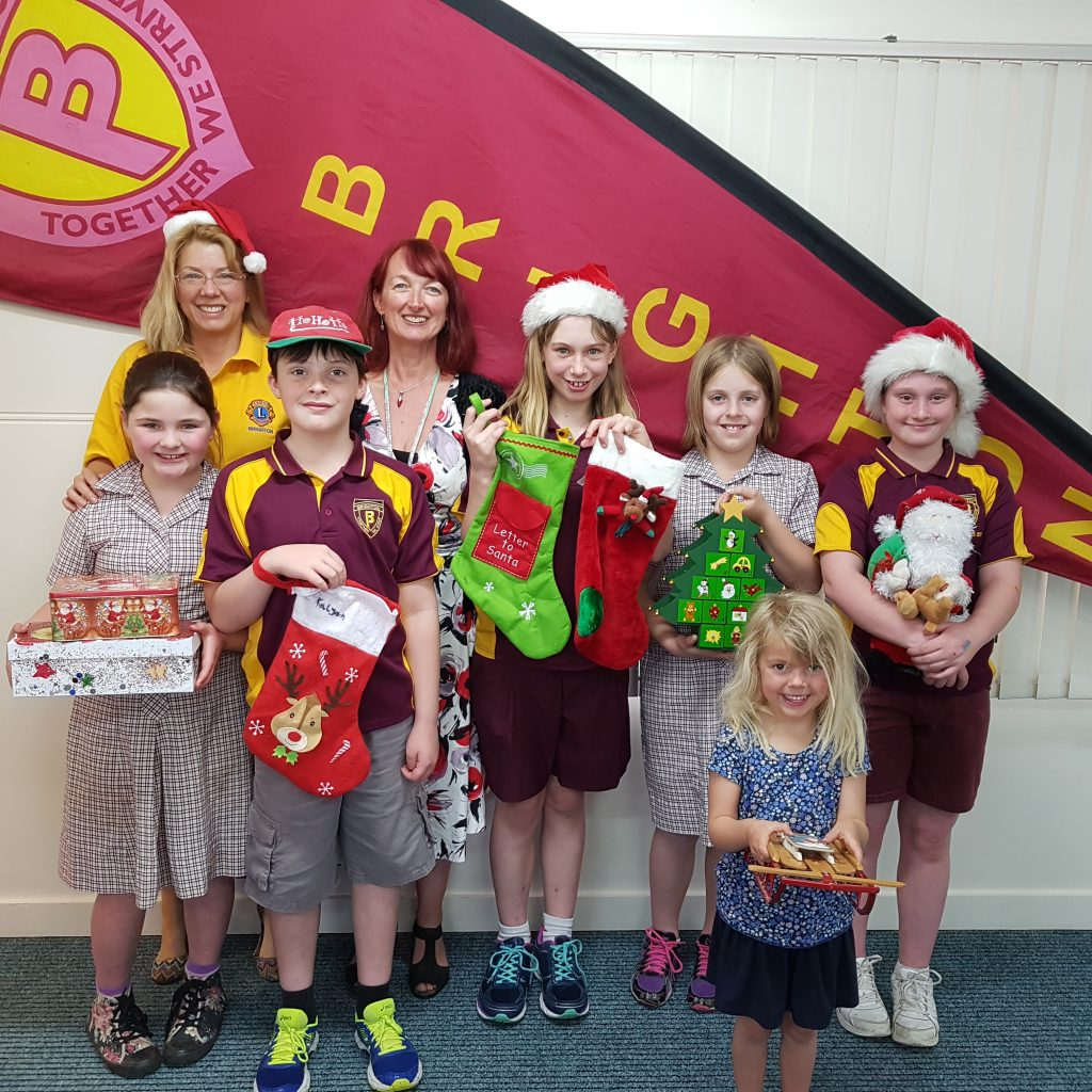 From left, getting into the Christmas spirit are Abbie D, Gwen Harper, Brighton Lions Treasurer, Liam C, Ange Miezitis, principal of Brighton Primary, Kiara J, Graciella S, Jasmine H and Angel H.