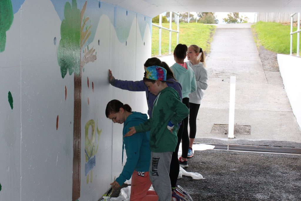 SRC students from East Derwent Primary School have completed their first project, painting the underpass near the school.  The mural provides the backdrop for a brighter, safer area for students to walk to school.