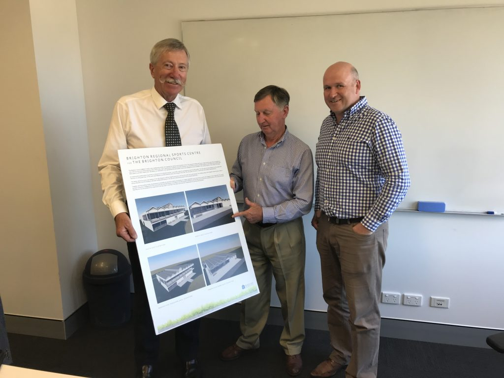 From left, general manager, Ron Sanderson, Mayor Tony Foster and Cricket Tasmania chief executive Nick Cummins examine the plans for the new Pontville Sports Complex.