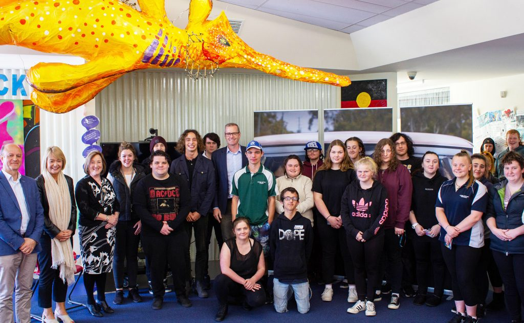 Minister for Transport Michael Ferguson, FIA Formula 3 Driver Alex Peroni and students from the Jordan River Learning Federation.